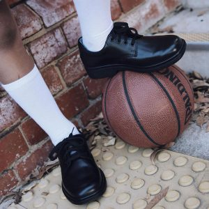 Child's school shoes on a basketball