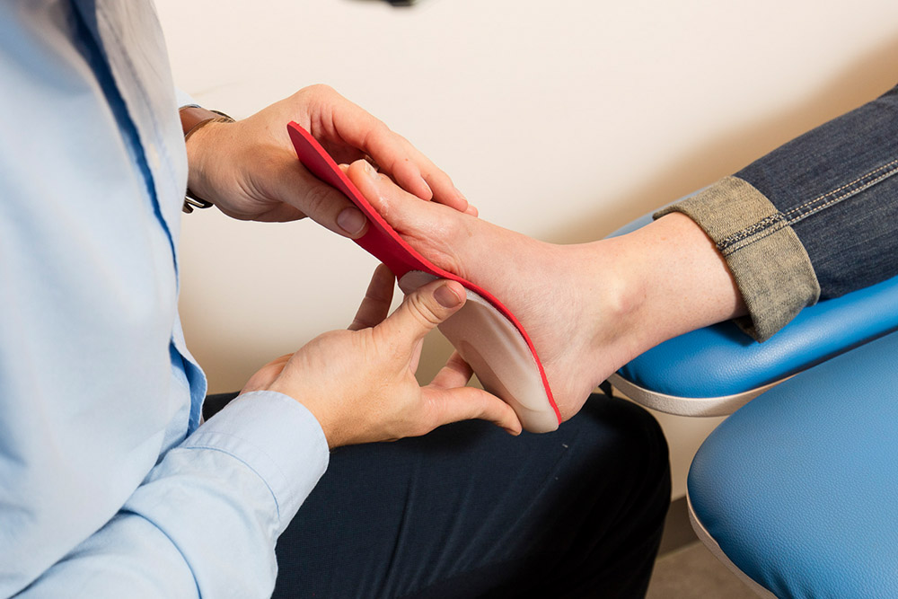 Custom foot orthotics treatment