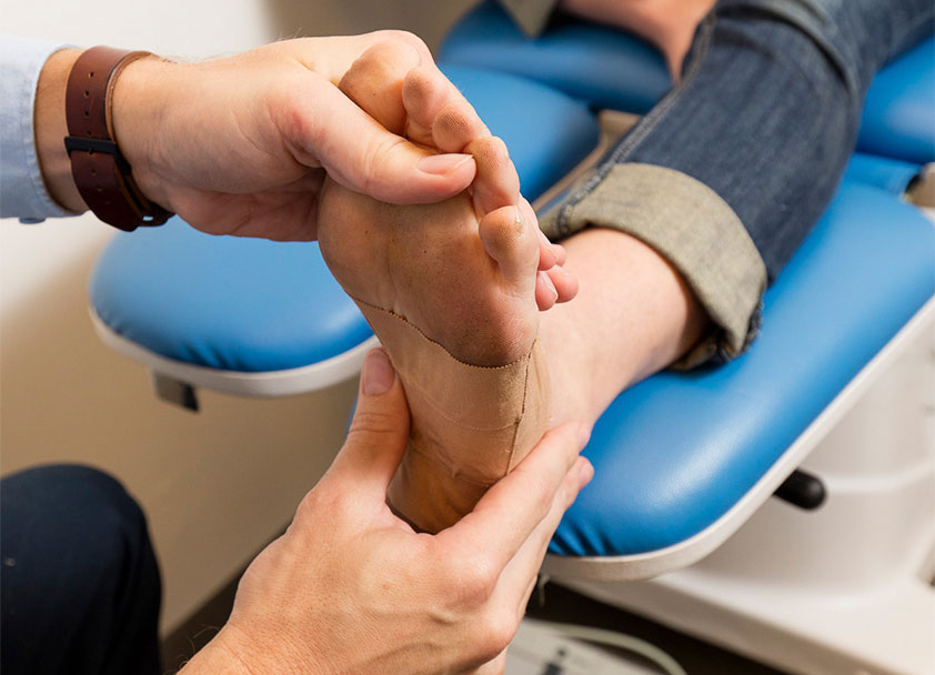 MyFootDr Podiatrist checking a patient's foot