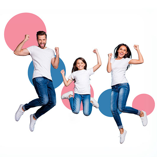 Happy family jumping in front of My FootDr blue and rose coloured circles
