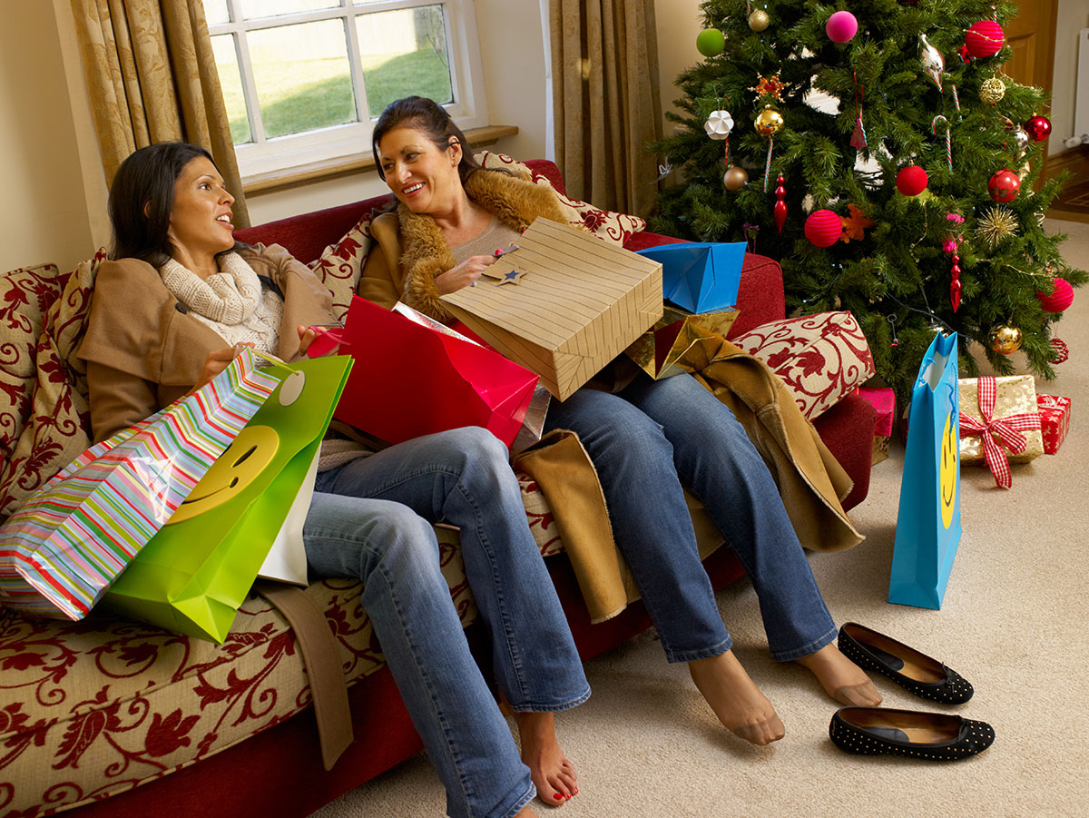 Women sore feet Christmas shopping