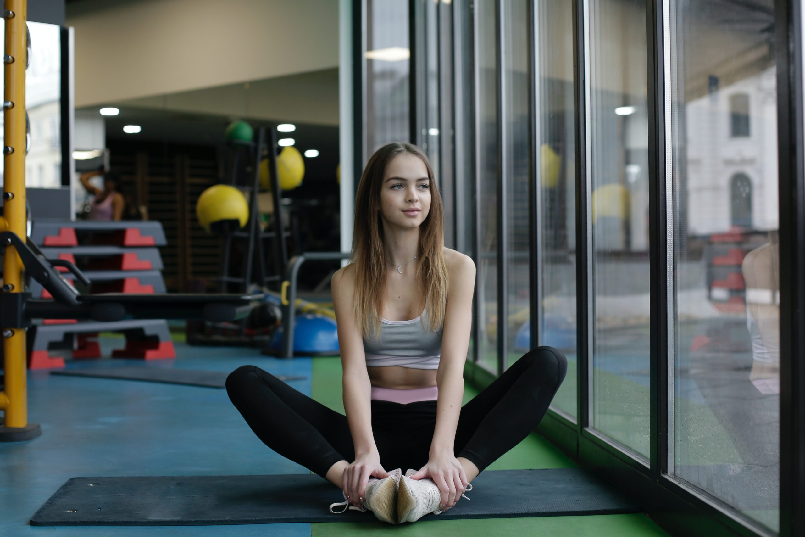 Young women stretching in gym
